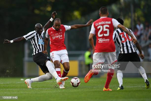 Wilson of SC Braga competes for the ball with Mo Diame of Newcastle during the Preseason friendly between SC Braga and Newcastle on August 1 2018 in...