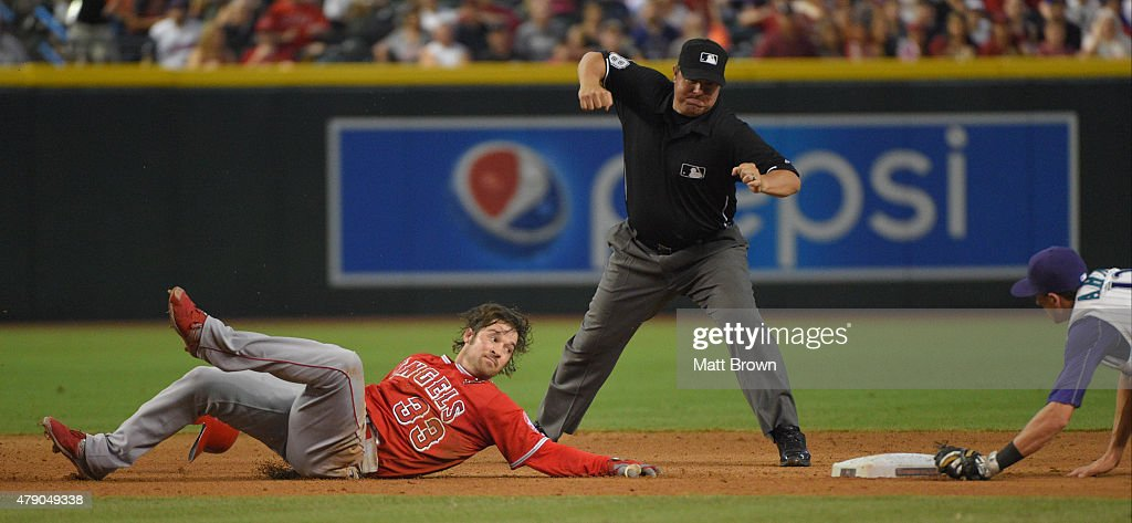 C.J. Wilson #33 of the Los Angeles Angels of Anaheim reacts as umpire Doug Eddings #88 signals him out after being tagged by Nick Ahmed while trying to stretch a double during the fifth inning of the game at Chase Field on June 18, 2015 in Phoenix, Arizona.