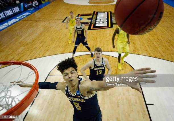 J Wilson of the Michigan Wolverines blocks a shot in the first half against the Oregon Ducks during the 2017 NCAA Men's Basketball Tournament Midwest...
