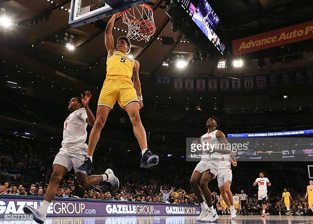 J Wilson of the Michigan Wolverines celebrates after a dunk against the Southern Methodist Mustangs in the first half of the 2K Classic Championship...