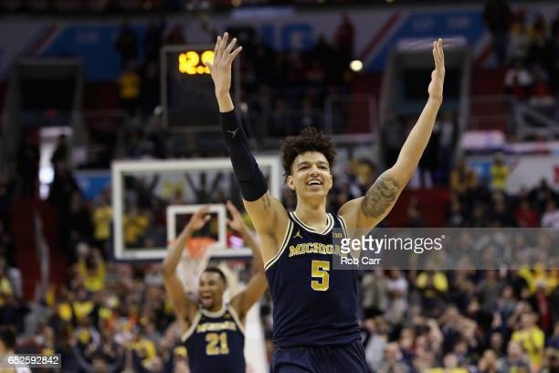 J Wilson of the Michigan Wolverines celebrates during the closing seconds of their 7156 win over the Wisconsin Badgers to win the Big Ten Basketball...