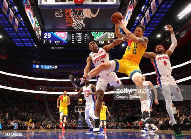 J Wilson of the Milwaukee Bucks battles for the ball with Bruce Brown and Stanley Johnson of the Detroit Pistons during the first half at Little...