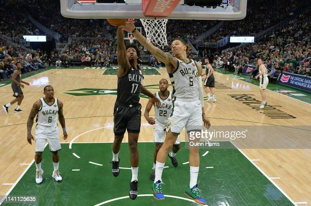 J Wilson of the Milwaukee Bucks blocks the shot of Ed Davis of the Brooklyn Nets in the first half at Fiserv Forum on April 06 2019 in Milwaukee...