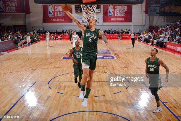 J Wilson of the Milwaukee Bucks drives to the basket during the game against the Denver Nuggets during the 2018 Las Vegas Summer League on July 9...