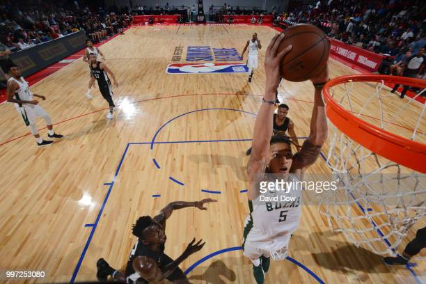 J Wilson of the Milwaukee Bucks dunks the ball against the San Antonio Spurs during the 2018 Las Vegas Summer League on July 12 2018 at the Cox...