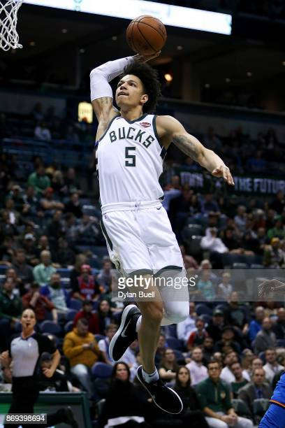 J Wilson of the Milwaukee Bucks dunks the ball in the fourth quarter against the Oklahoma City Thunder at the Bradley Center on October 31 2017 in...