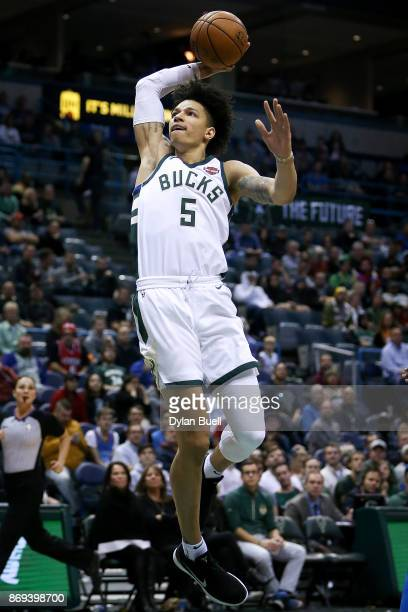 J Wilson of the Milwaukee Bucks dunks the ball in the fourth quarter against the Oklahoma City Thunder at the Bradley Center on October 31 2017 in...