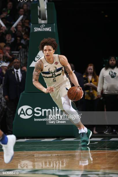 DJ Wilson of the Milwaukee Bucks handles the ball against the Orlando Magic on April 9 2018 at the BMO Harris Bradley Center in Milwaukee Wisconsin...