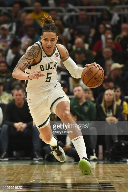 J Wilson of the Milwaukee Bucks handles the ball during a game against the Orlando Magic at Fiserv Forum on February 09 2019 in Milwaukee Wisconsin...