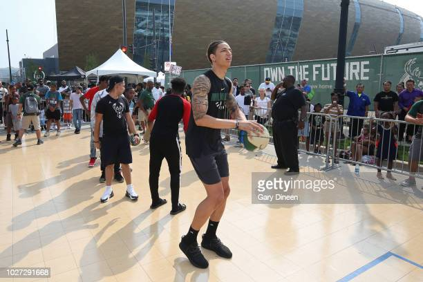 J Wilson of the Milwaukee Bucks shoots the ball at a clinic during an open house and block party in honor of the opening of Fiserv Forum on August 26...