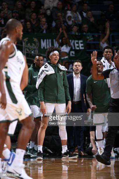 J Wilson of the Milwaukee Bucks with his teammates react to a play against the Detroit Pistons on December 6 2017 at the BMO Harris Bradley Center in...