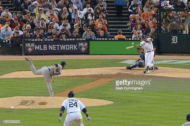 J Wilson of the Texas Rangers pitches to Victor Martinez of the Detroit Tigers during Game Five of the American League Championship Series at...