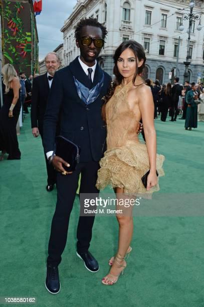 Wilson Oryema and Doina Ciobanu, wearing Jean-Louis Sabaji Couture, attend The Green Carpet Fashion Awards Italia 2018 at Teatro Alla Scala on...