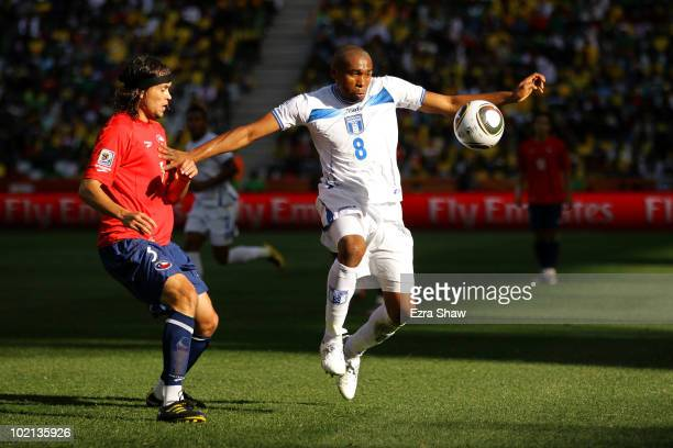Wilson Palacios of Honduras holds off Waldo Ponce of Chile during the 2010 FIFA World Cup South Africa Group H match between Honduras and Chile at...