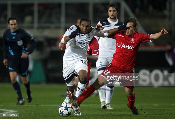 Wilson Palacios of Tottenham is challenged by Wout Brama of Twente during the UEFA Champions League Group A match between FC Twente and Tottenham...
