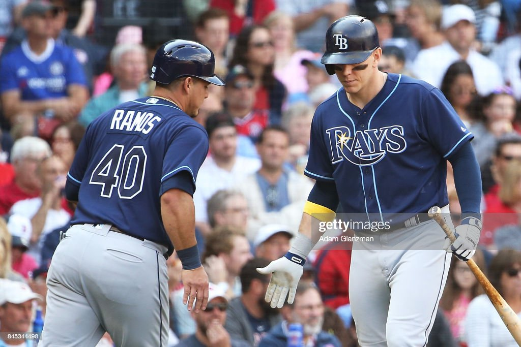 Wilson Ramos #40 high fives Kevin Kiermaier #39 of the Tampa Bay Rays as returns to the dugout after scoring in the fifth inning of a game against the Boston Red Sox at Fenway Park on September 10, 2017 in Boston, Massachusetts.