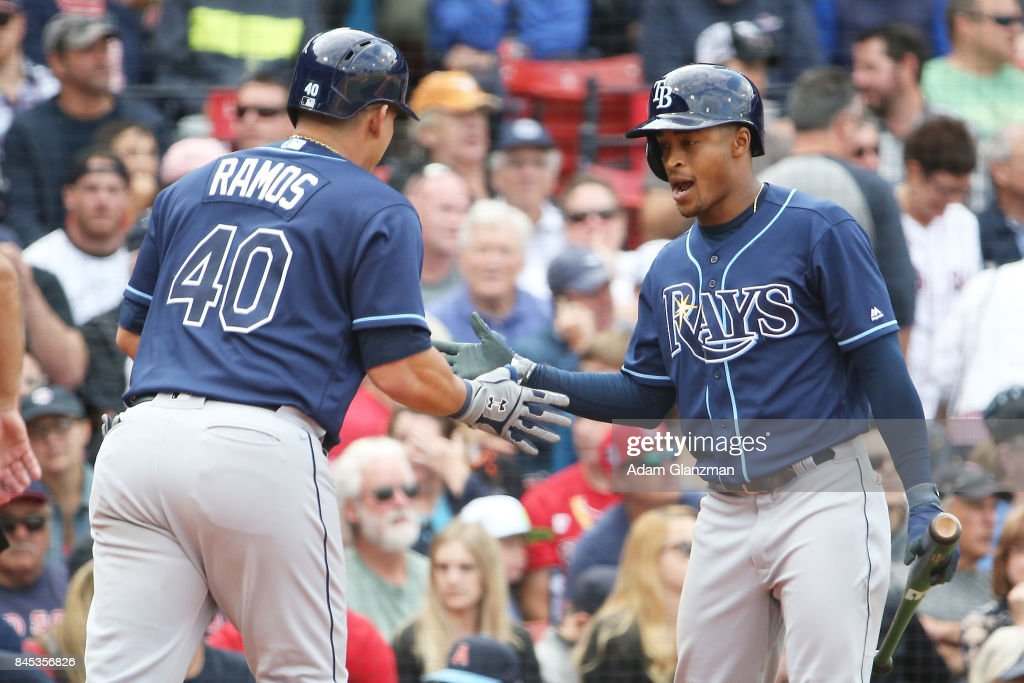 Wilson Ramos #40 high fives Mallex Smith #0 of the Tampa Bay Rays as he returns to the dugout after hitting a solo home run in the sixth inning of a game against the Boston Red Sox at Fenway Park on September 10, 2017 in Boston, Massachusetts.