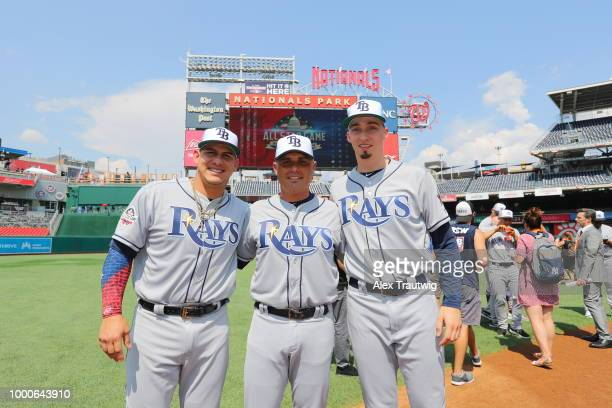 Wilson Ramos manager Kevin Cash and Blake Snell of the Tampa Bay Rays on the field during the Gatorade AllStar Workout Day at Nationals Park on...