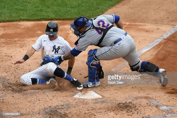 Wilson Ramos of the New York Mets tags out Mike Tauchman of the New York Yankees at home during the fourth inning at Yankee Stadium on August 29 2020...