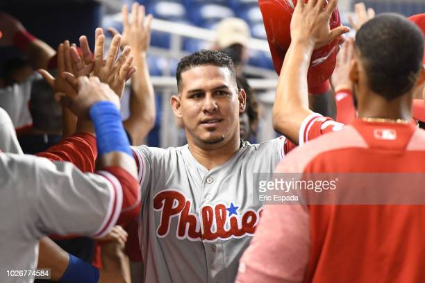 Wilson Ramos of the Philadelphia Phillies is congratulated by teammates after scoring in the first inning against the Miami Marlins at Marlins Park...