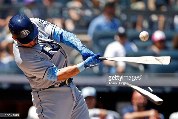 Wilson Ramos of the Tampa Bay Rays breaks his bat on a single against the New York Yankees during the first inning at Yankee Stadium on June 17 2018...
