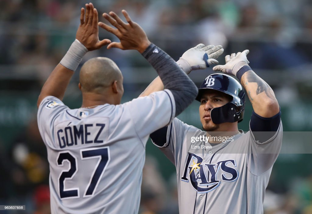 Wilson Ramos #40 of the Tampa Bay Rays is congratulated by Carlos Gomez #27 after he hit a home run off of Daniel Gossett #48 of the Oakland Athletics in the third inning at Oakland Alameda Coliseum on May 29, 2018 in Oakland, California.