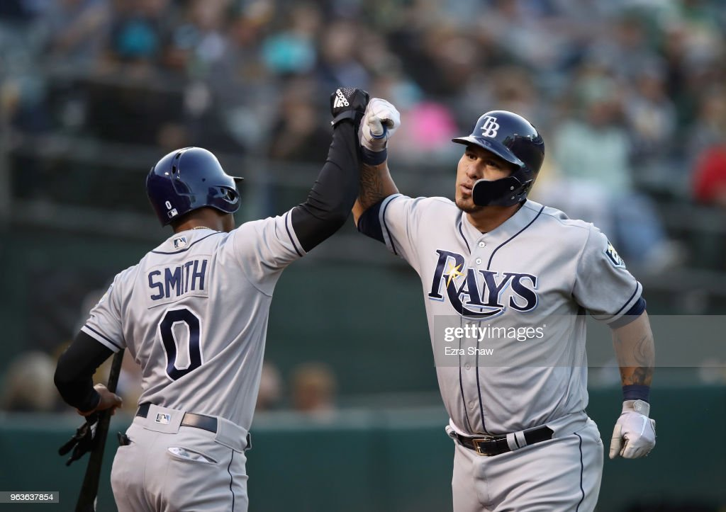 Wilson Ramos #40 of the Tampa Bay Rays is congratulated by Mallex Smith #0 after he hit a home run off of Daniel Gossett #48 of the Oakland Athletics in the third inning at Oakland Alameda Coliseum on May 29, 2018 in Oakland, California.