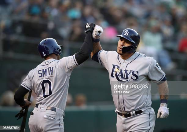 Wilson Ramos of the Tampa Bay Rays is congratulated by Mallex Smith after he hit a home run off of Daniel Gossett of the Oakland Athletics in the...