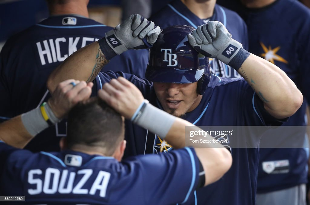 Wilson Ramos #40 of the Tampa Bay Rays is congratulated by teammates after hitting a solo home run in the fourth inning during MLB game action against the Toronto Blue Jays at Rogers Centre on August 15, 2017 in Toronto, Canada.