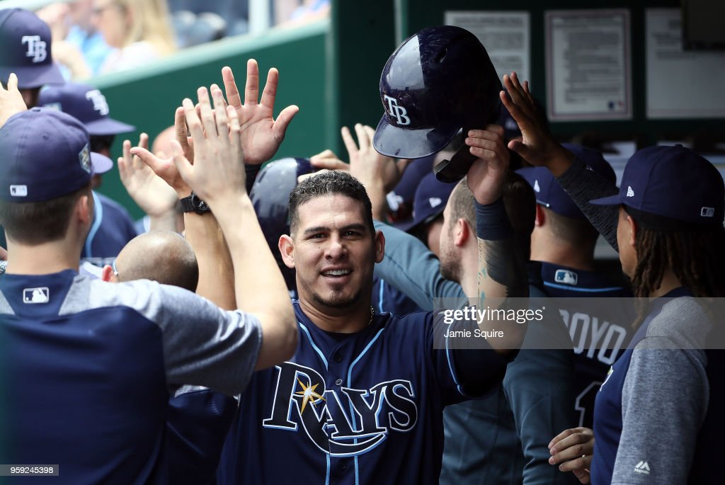 Wilson Ramos #40 of the Tampa Bay Rays is congratulated by teammates in the dugout after scoring during the 1st inning of the game against the Kansas City Royals at Kauffman Stadium on May 16, 2018 in Kansas City, Missouri.