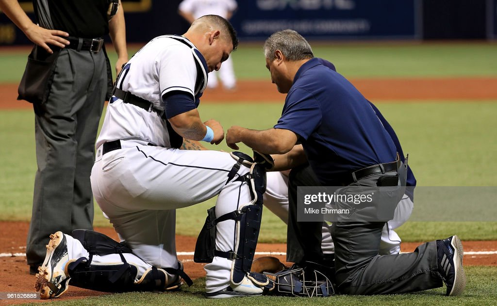 Wilson Ramos #40 of the Tampa Bay Rays leaves the game with an injury in the third inning during a game against the Boston Red Sox at Tropicana Field on May 22, 2018 in St Petersburg, Florida.