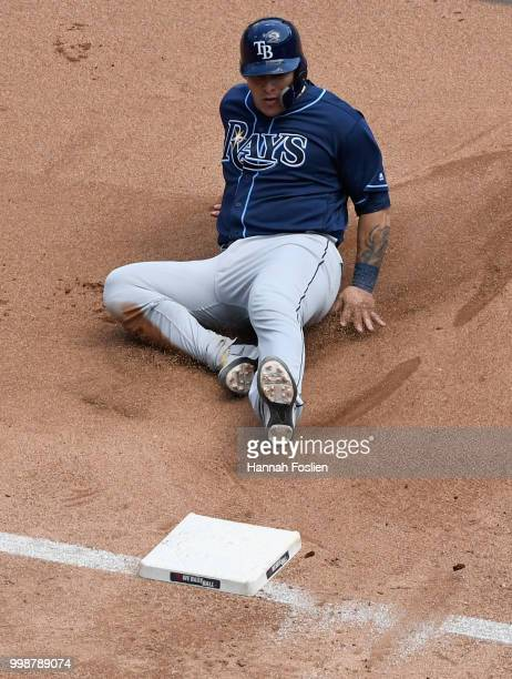 Wilson Ramos of the Tampa Bay Rays slides safely into third base against the Minnesota Twins during the fourth inning of the game on July 14 2018 at...