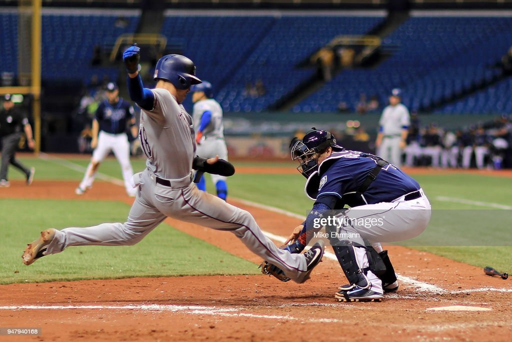 Wilson Ramos #40 of the Tampa Bay Rays tags out Drew Robinson #18 of the Texas Rangers trying to score in the eighth inning during a game at Tropicana Field on April 17, 2018 in St Petersburg, Florida.