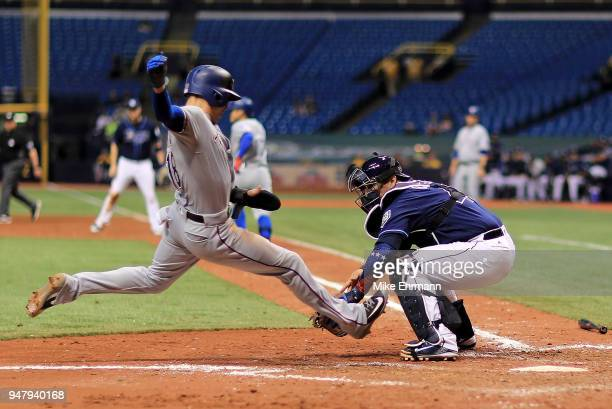 Wilson Ramos of the Tampa Bay Rays tags out Drew Robinson of the Texas Rangers trying to score in the eighth inning during a game at Tropicana Field...