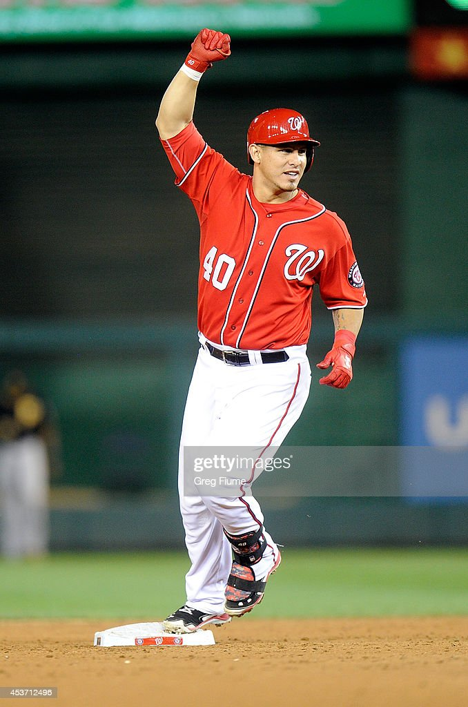 Wilson Ramos #40 of the Washington Nationals celebrates after driving in the game winning run in the ninth inning against the Pittsburgh Pirates at Nationals Park on August 16, 2014 in Washington, DC. Washington won the game 4-3.