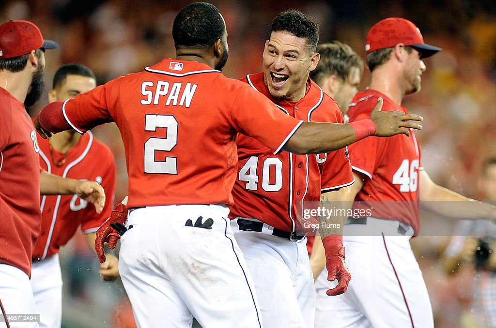 Wilson Ramos #40 of the Washington Nationals celebrates with Denard Span #2 after driving in the game winning run in the ninth inning against the Pittsburgh Pirates at Nationals Park on August 16, 2014 in Washington, DC. Washington won the game 4-3.