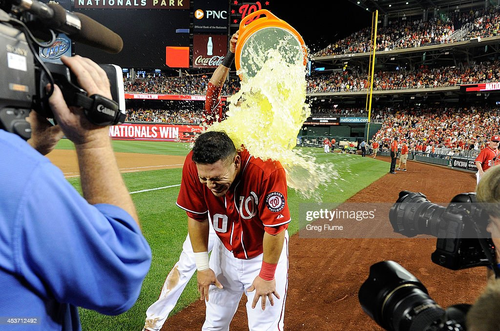 Wilson Ramos #40 of the Washington Nationals is doused with gatorade after driving in the game winning run in the ninth inning against the Pittsburgh Pirates at Nationals Park on August 16, 2014 in Washington, DC. Washington won the game 4-3.