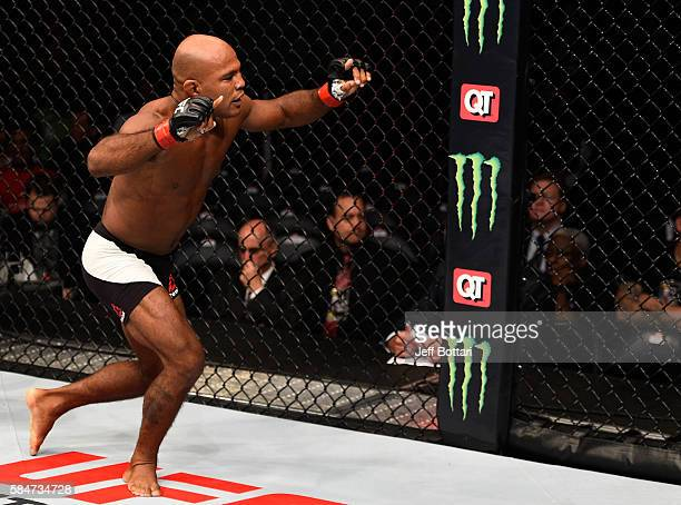 Wilson Reis celebrates his submission victory over Hector Sandoval in their flyweight bout during the UFC 201 event on July 30 2016 at Philips Arena...