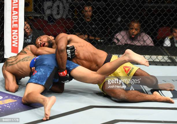 Wilson Reis of Brazil takes down John Moraga in their flyweight fight during the UFC Fight Night event at the Gila Rivera Arena on April 14 2018 in...