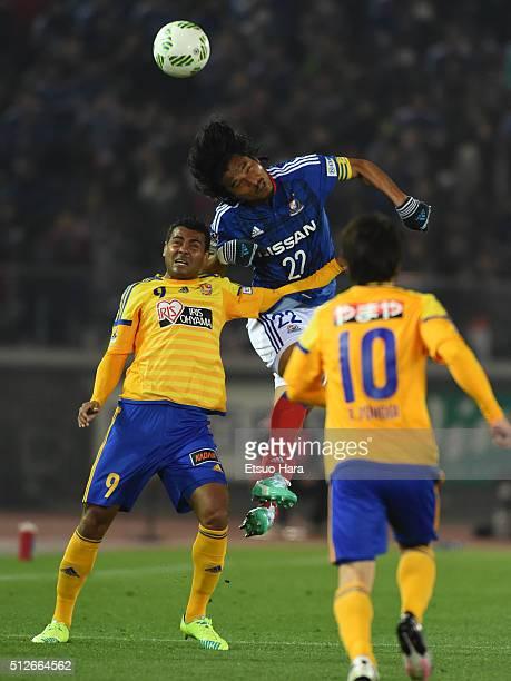 Wilson Rodrigues Fonseca of Vegalta Sendai and Yuji Nakazawa of Yokohama FMarinos compete for the ball during the JLeague match between Yokohama...
