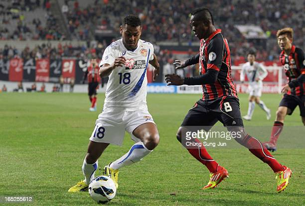 Wilson Rodrigues Fonseca of Vegalta Sendai tussles for possession with Adilson Dos Santos of FC Seoul during the AFC Champions League Group E match...