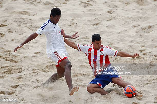 Wilson Rodriguez of Paraguay battles for the ball with Tovonay Pierralit of Madagascar during the Group D FIFA Beach Soccer World Cup match between...