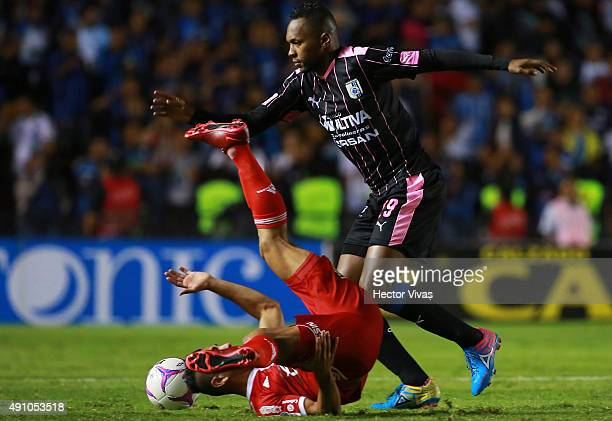 Wilson Tiago of Queretaro struggles for the ball with Felipe Flores of Tijuana during the 12th round match between Queretaro and Tijuana as part of...