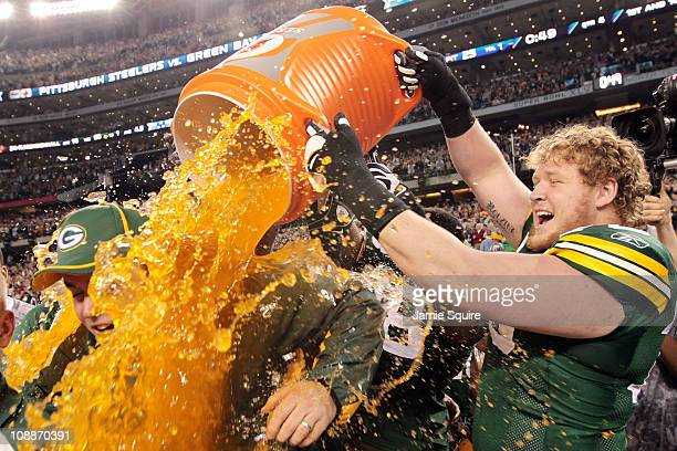 Wilson, T.J. Lang and Ryan Pickett of the Green Bay Packers dump Gatorade on head coach Mike McCarthy after they defeated the Pittsburgh Steelers 31...