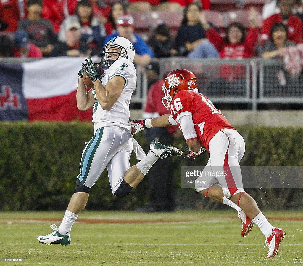 Wilson Van Hooser #9 of the Tulane Green Wave reels in a pass as he beats Adrian McDonald #16 of the Houston Cougars at Robertson Stadium on November 24, 2012 in Houston, Texas. Houston defeats Tulane 40-17.