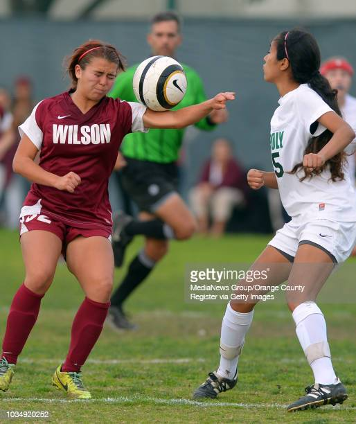 Wilson's Cassie Mikalson gets away with a hand ball as she'd defended by Poly's Daria Manzano in Long Beach CA on Tuesday January 21 2014 Poly...