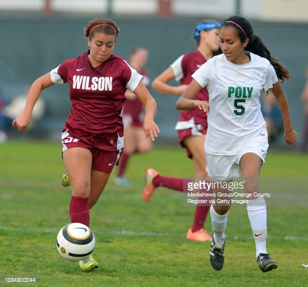 Wilson's Cassie Mikalson is defended by Poly's Daria Manzano in Long Beach CA on Tuesday January 21 2014 Poly defeated Wilson 10 in girls soccer