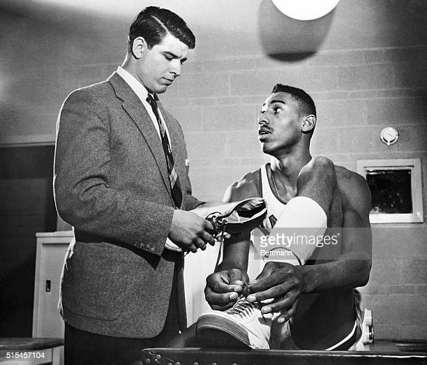 Wilt Chamberlain , 7 foot, 2 inch Kansas University freshman cage wizard, has completed his debut in college basketball, scholarship and society here...