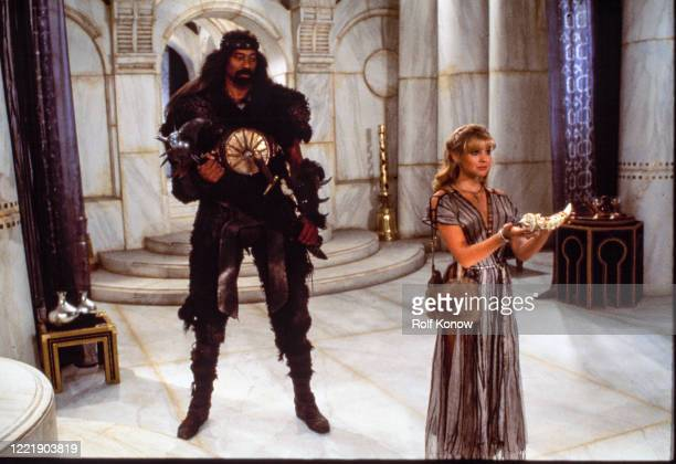 """Wilt Chamberlain and Olivia d'Abo on the set of """"Conan the destroyer, directed by Richard Fleischer, Mexico City, Mexico, 1983"""
