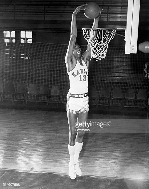 Wilt Chamberlain is shown going up for the basket. Undated photograph.